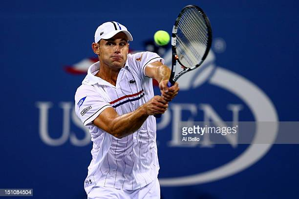 Andy Roddick of the United States returns a shot during his men's singles second round match against Bernard Tomic of Australia on Day Five of the...