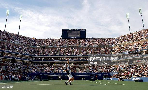 Andy Roddick of the United States serves in the Arthur Ashe Stadium to Juan Carlos Ferrero of Spain in the men's final match 07 September at the US...