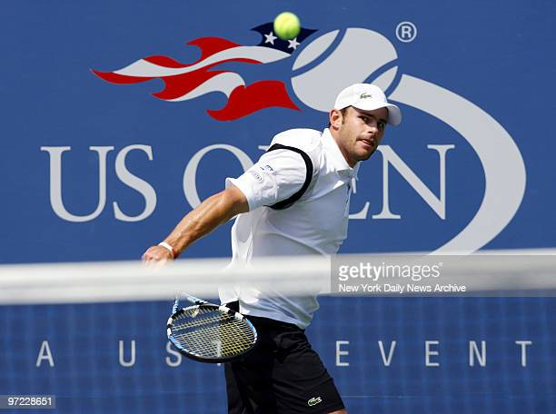 Andy Roddick of the United States slices a backhand shot during his fourthround 2007 US Open match against Tomas Berdych of the Czech Republic in...