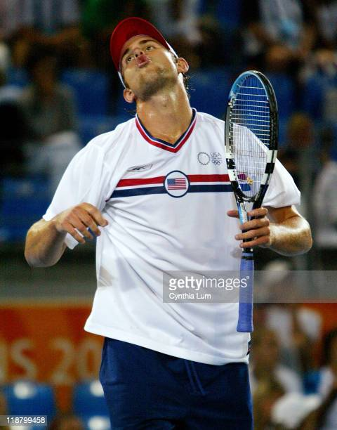 Andy Roddick of the United States wins a point after trailing 5-6 behind Tommy Haas of Germany during the Athens 2004 Olympics Games at Goudi Olympic...