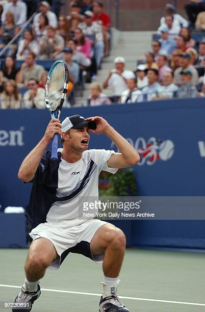 Andy Roddick of the US drops to his knees crying after defeating Juan Carlos Ferrero of Spain in the US Open men's final at Flushing MeadowsCorona...