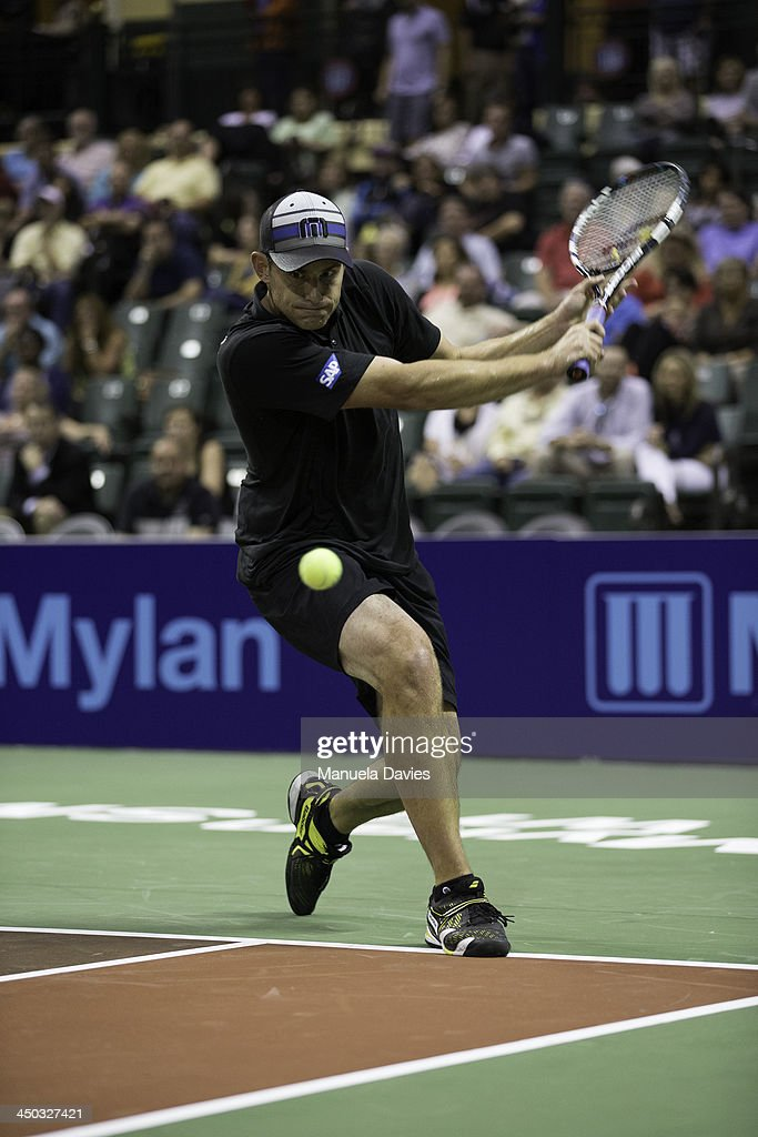 Andy Roddick of the U.S. hits a backhand during the exhibition singles match against John Isner during the 2013 Mylan WTT Smash Hits on November 17, 2013 at the ESPN Wide World of Sports Complex in Lake Buena Vista, Florida.