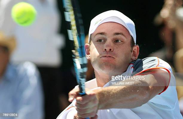 Andy Roddick of the US hits a backhand return on the way to victory over Marcos Baghdatis of Cyprus during the final of the Kooyong Classic in...
