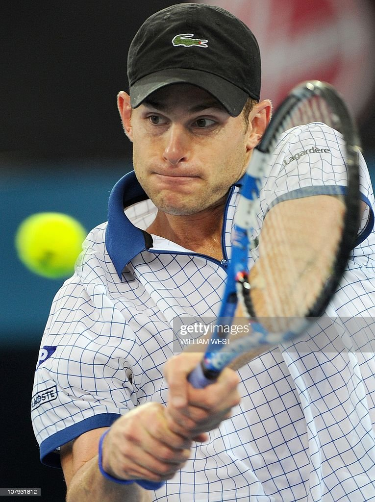 Andy Roddick of the US hits a backhand r : News Photo