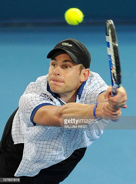 Andy Roddick of the US hits a backhand return to Kevin Anderson of South Africa in their semifinal match at the Brisbane International tennis...