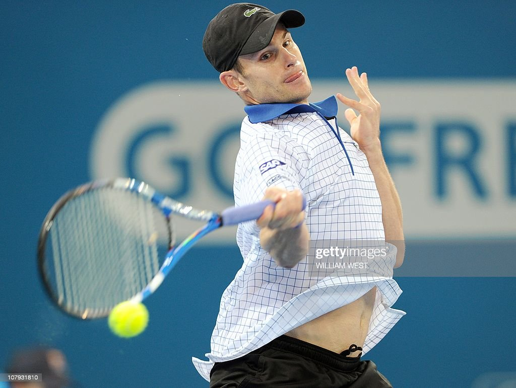 Andy Roddick of the US hits a forehand r : News Photo