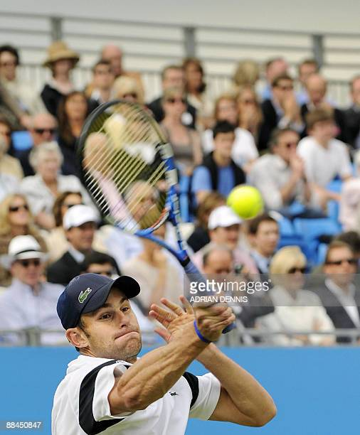 Andy Roddick of the US hits a shot against Ivo Karlovic of Croatia during the quarterfinal match at The AEGON Championships tennis tournament at...