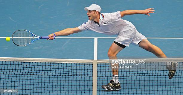 Andy Roddick of the US lunges for a volley while playing Feliciano Lopez of Spain during their men's singles three round match on day five of the...