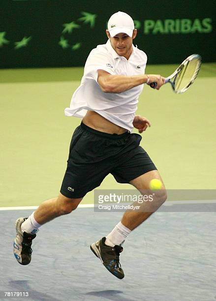 Andy Roddick of the U.S. Returns the ball against Dmitry Tursunov of Russia during the opening match of the Davis Cup Final at the Memorial Coliseum...
