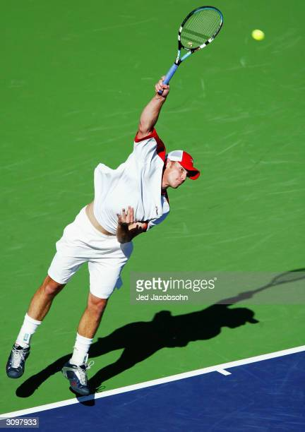 Andy Roddick of the U.S. Serves against Marat Safin of Russia at the Pacific Life Open March 15, 2004 at the Indian Wells Tennis Garden in Indian...