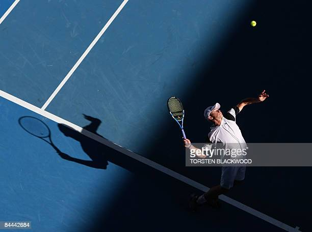 Andy Roddick of the US serves the ball to Tommy Robredo of Spain during the men's tennis match on the seventh day of the Australian Open in Melbourne...