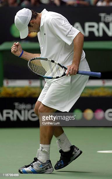 Andy Roddick of the USA celebrates his 63 36 61 57 64 win over Mario Ancic in the fourth round of the Australian Open in Melbourne Australia on...