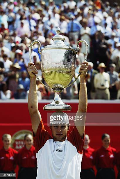 Andy Roddick of the USA holds the trophy up after victory over Sebastien Grosjean of France in the Final of the Stella Artois Championships held on...