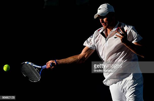 Andy Roddick of the USA playing with James Blake of the USA plays a forehand in his mens doubles semi-final match against Marc Gicquel of France...