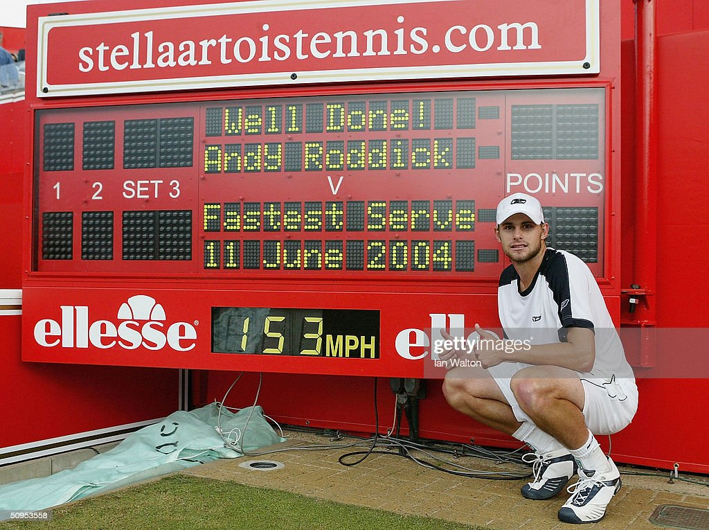 Andy Roddick of the USA poses next to the official scoreboard showing his world record serve speed after his victory over Lleyton Hewitt of Australia in the semi-final match at the Stella Artois Tennis Championships at the Queen?s Club June 12, 2004 in London.
