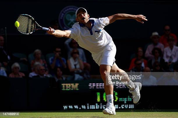 Andy Roddick of the USA reaches for a shot during his Gentlemen's Singles third round match against David Ferrer of Spain on day six of the Wimbledon...