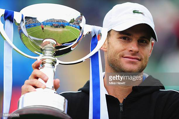 Andy Roddick of USA holds aloft the winner's trophy after defeating Andreas Seppi of Italy in the Men's Final during the AEGON International at...