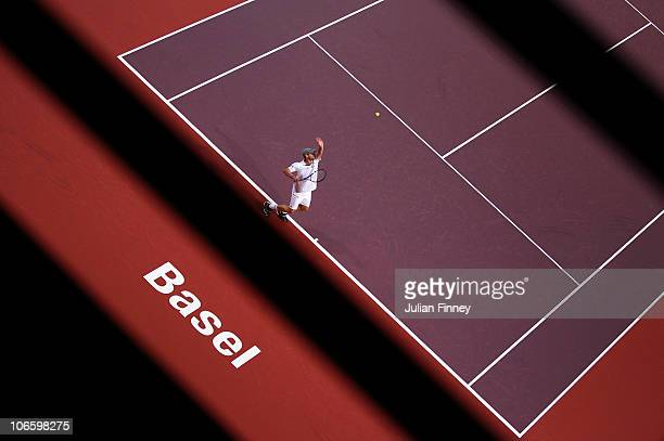 Andy Roddick of USA serves to Roger Federer of Switzerland during Day Six of the Davidoff Swiss Indoors Tennis at St Jakobshalle on November 6, 2010...