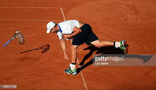 Andy Roddick of USA smashes his racket on the floor during his match against Go Soeda of Japan during day five of Power Horse World Team Cup at...