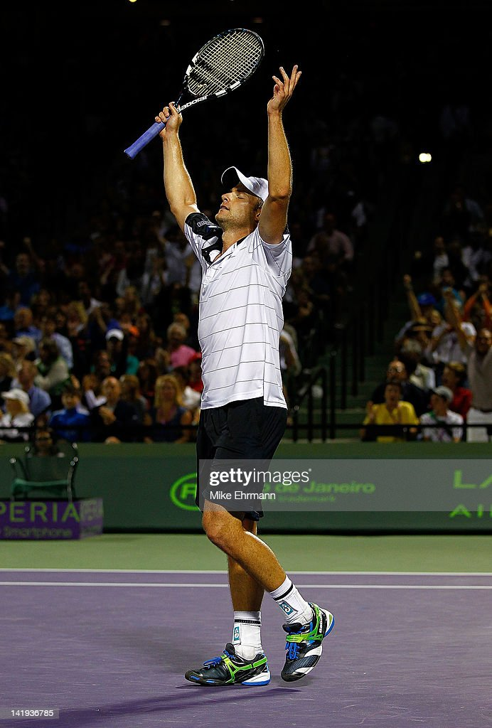 Andy Roddick reacts to beating Roger Federer of Switzerland during Day 8 of the Sony Ericsson Open at Crandon Park Tennis Center on March 26, 2012 in Key Biscayne, Florida.