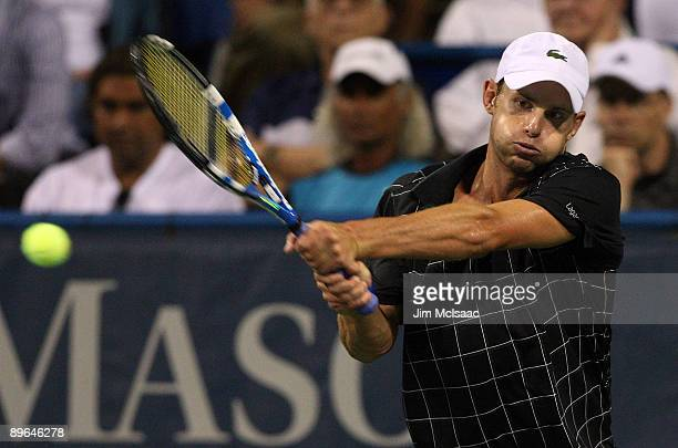 Andy Roddick returns a shot against Sam Querrey during Day 4 of the Legg Mason Tennis Classic at the William H.G. FitzGerald Tennis Center on August...
