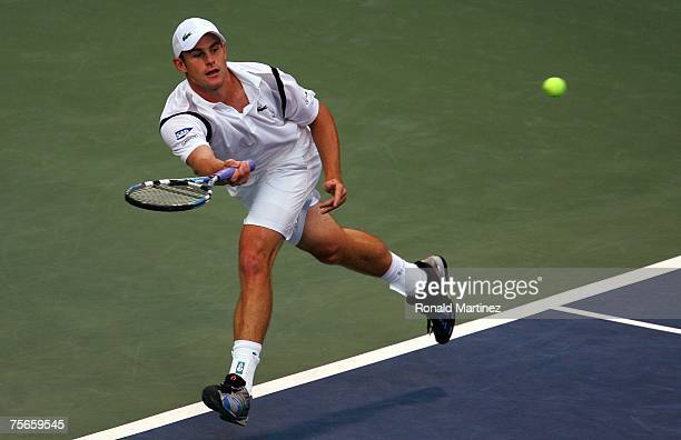 Andy Roddick returns a shot to Evgeny Korolev of Russia during the Indianapolis Tennis Championships on July 25 2007 at the Indianapolis Tennis...
