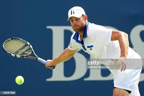 Andy Roddick returns a shot to Gilles Muller of Luxemburg during the finals of the BB&T Atlanta Open at Atlantic Station on July 22, 2012 in Atlanta,...