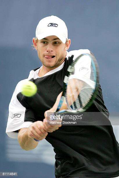 Andy Roddick returns a shot to Nicolas Kiefer of Germany during the finals of the RCA Championships July 25 2004 at the Indianapolis Tennis Center in...