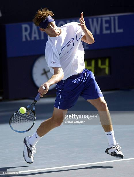 Andy Roddick returns a shot to Xavier Malisse in the quarterfinals of the 2002 MercedesBenz Cup Roddick defeated Malisse 64 64