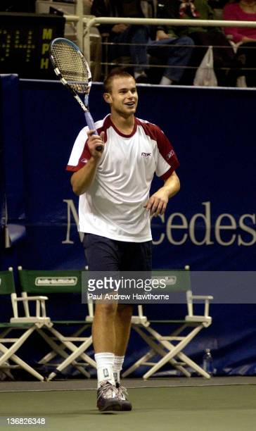 Andy Roddick shares a laugh with the fans during his match with Kristof Vliegen of Belgium at the 2004 Siebel Open in San Jose, California, February...