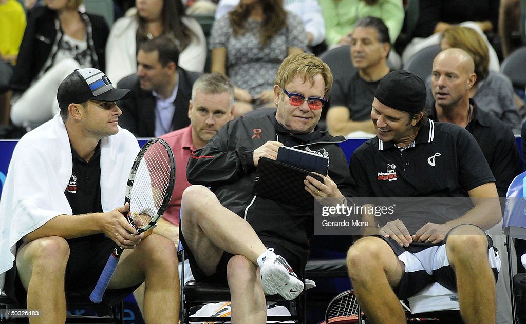 Andy Roddick (L) Singer Sir Elton John (C) and Robert Kendrick smile during the Mylan World TeamTennis Matches at ESPN Wide World of Sports Complex on November 17, 2013 in Lake Buena Vista, Florida.