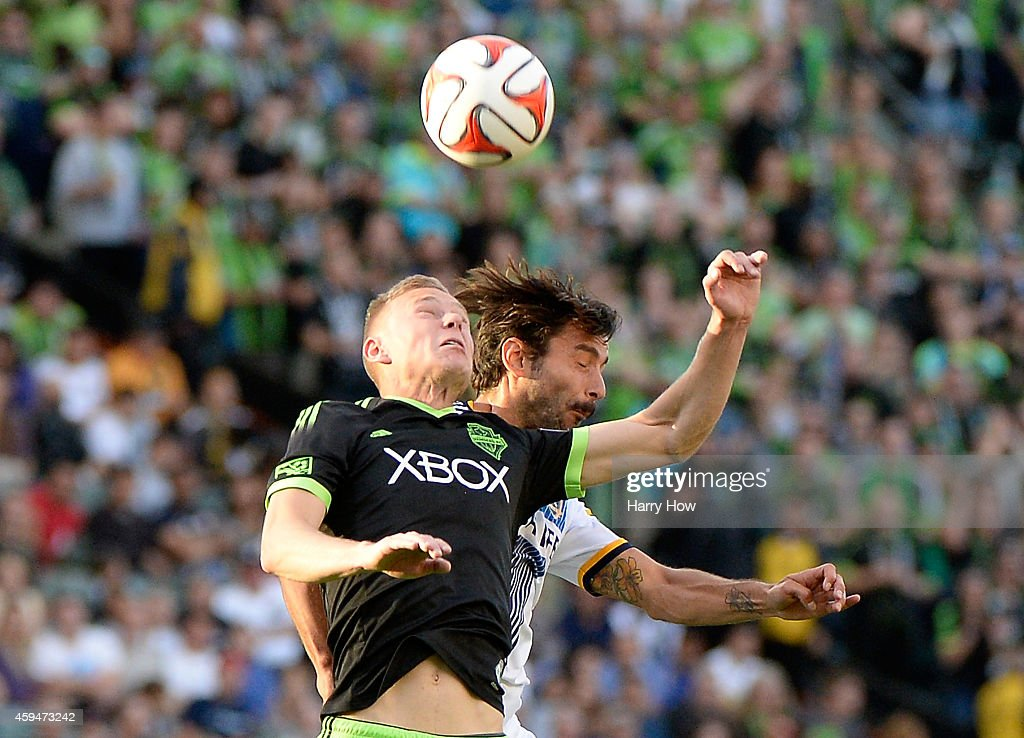 Andy Rose #5 of Seattle Sounders FC and Baggio Husidic #6 of Los Angeles Galaxy head the ball during a 2-1 Galaxy win in the Western Conference Final at StubHub Center on November 23, 2014 in Los Angeles, California.