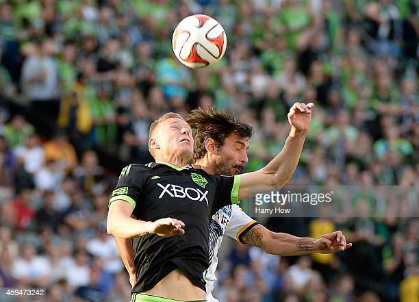 Andy Rose of Seattle Sounders FC and Baggio Husidic of Los Angeles Galaxy head the ball during a 21 Galaxy win in the Western Conference Final at...