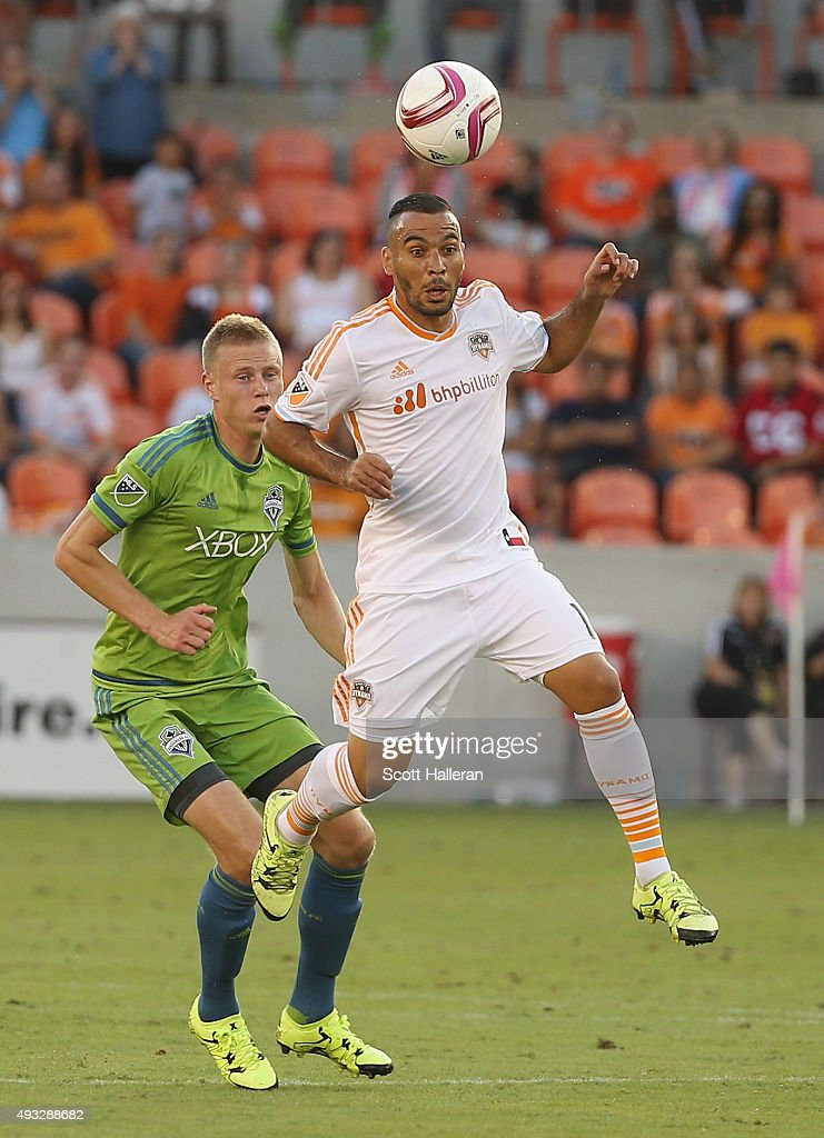 Andy Rose #5 of the Seattle Sounders FC and Alex #14 of the Houston Dynamo battle for the ball in the second half of their game at BBVA Compass Stadium on October 18, 2015 in Houston, Texas.