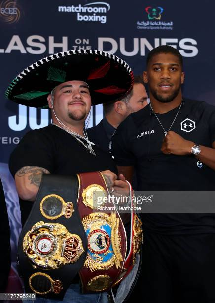 Andy Ruiz Jr and Anthony Joshua pose for a photo during the press conference for Ruiz v Joshua 2 'Clash on the Dunes' at the Hilton Syon Park on...