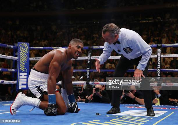 Andy Ruiz Jr knocks down Anthony Joshua in the seventh round during their IBF/WBA/WBO heavyweight title fight at Madison Square Garden on June 01...