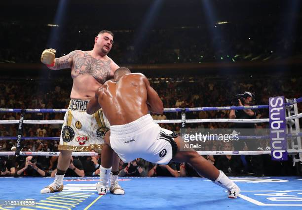 Andy Ruiz Jr knocks down Anthony Joshua in the third round during their IBF/WBA/WBO heavyweight title fight at Madison Square Garden on June 01 2019...