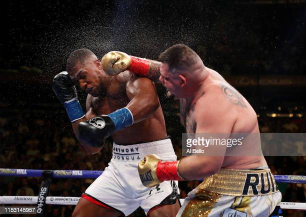 Andy Ruiz Jr punches Anthony Joshua after their IBF/WBA/WBO heavyweight title fight at Madison Square Garden on June 01 2019 in New York City
