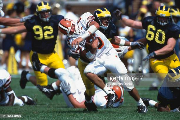 Andy Sahm Quarterback for the Bowling Green State Falcons is sacked during the NCAA Division IA Big 10 college football game against the University...