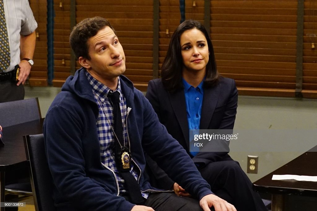 Andy Samberg and Melissa Fumero in the Game Night - The Favor special one hour episode of BROOKLYN NINE-NINE airing Tuesday, Dec. 12 (9:30-10:00 PM ET/PT) on FOX.