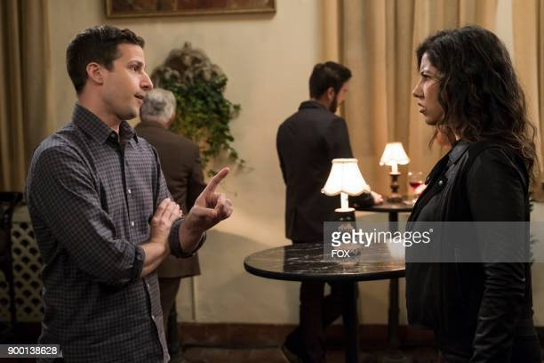 Andy Samberg and Stephanie Beatriz in the Game Night Godfather special one hour episode of BROOKLYN NINENINE airing Tuesday Dec 12 on FOX