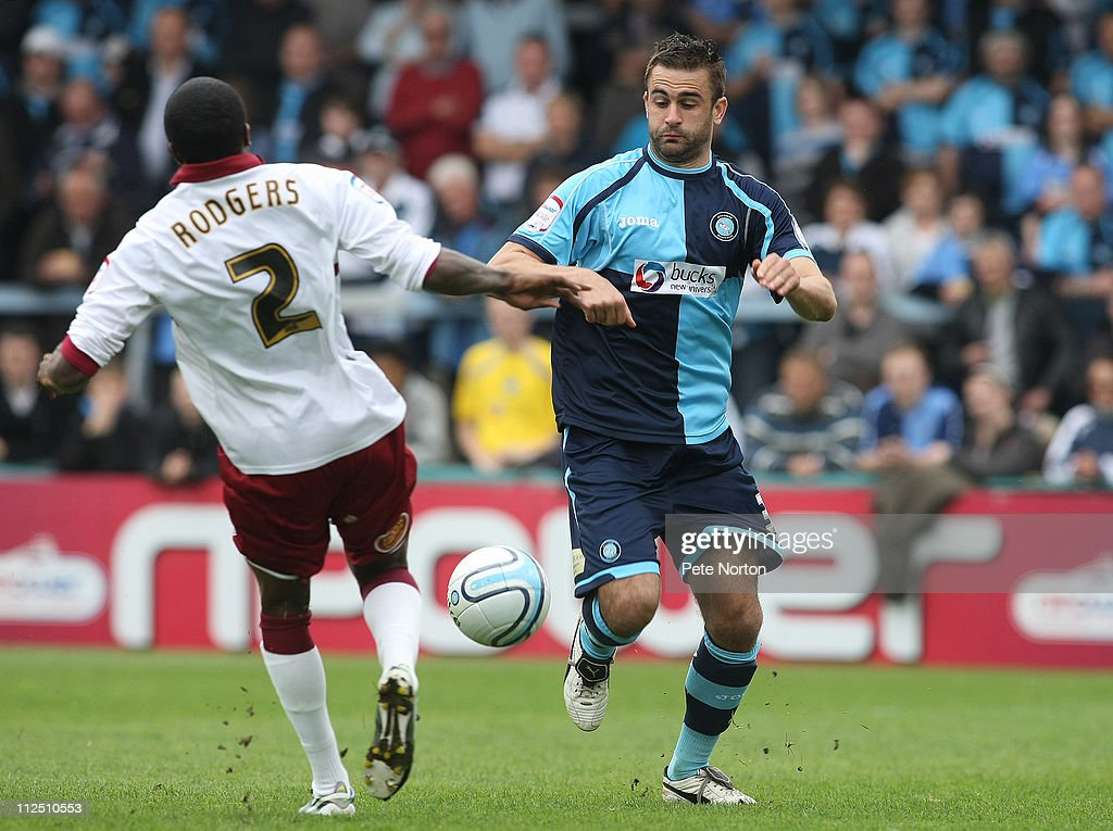 Andy Sandell of Wycombe Wanderers contests the ball with Paul Rodgers of Northampton Town during the npower League Two League match between Wycombe Wanderers and Northampton Town at Adams Parks on April 16, 2011 in Wycombe, England.
