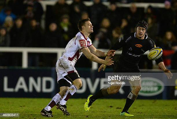 Andy Saull of Newcastle Falcons challenges Dwayne Peel of Sale Sharks on January 3 2014 in Newcastle Upon Tyne England Local Caption Dwayne Peel Andy...