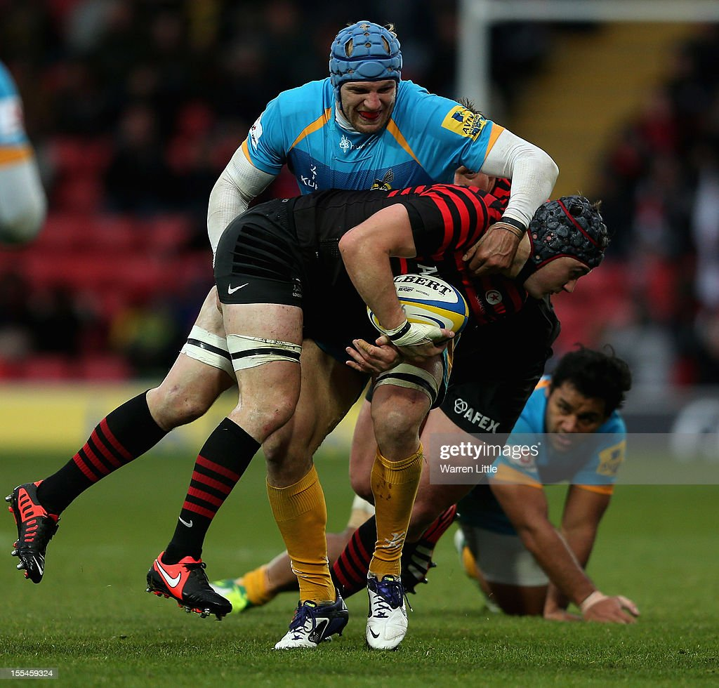 Andy Saull of Saracens is tackled by James Haskell of Wasps during the Aviva Premiership match between Saracens and London Wasps at Vicarage Road on November 4, 2012 in Watford, England.