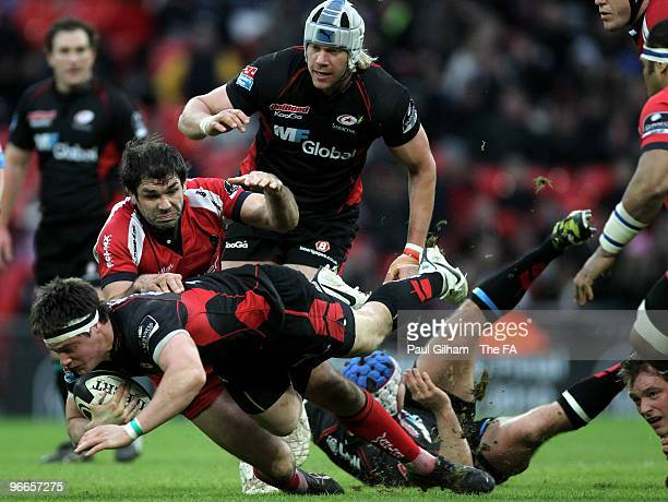 Andy Saull of Saracens is tackled by Pat Sanderson of Worcester Warriors during the Guinness Premiership match between Saracens and Worcester...