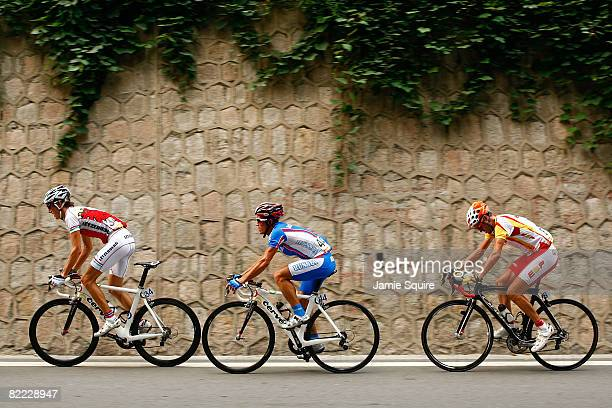 Andy Schleck of Luxembourg Alexander Kolobnev of Russia and Samuel Sanchez of Spain compete in the Men's Road Cycling event held on the Road Cycling...