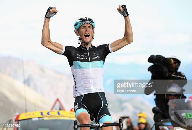 Andy Schleck of Luxembourg and Team LeopardTrek celebrates winning stage eighteen of the 2011 Tour de France from Pinerolo to Galibier Serre...