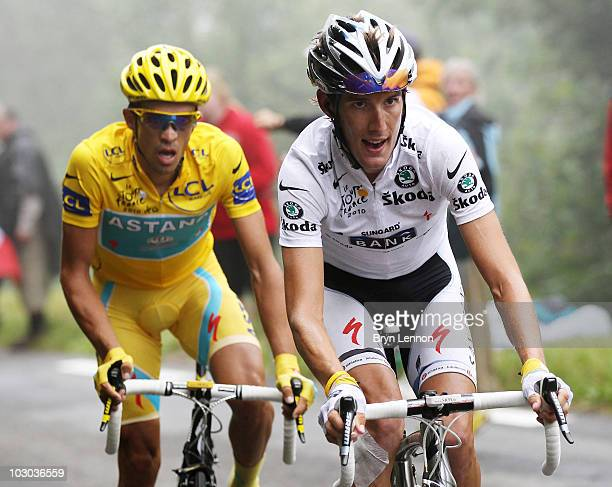Andy Schleck of Luxembourg and Team Saxo Bank is followed by Alberto Contador of Spain and the Astana Team as he attacks up the slopes of the Col du...