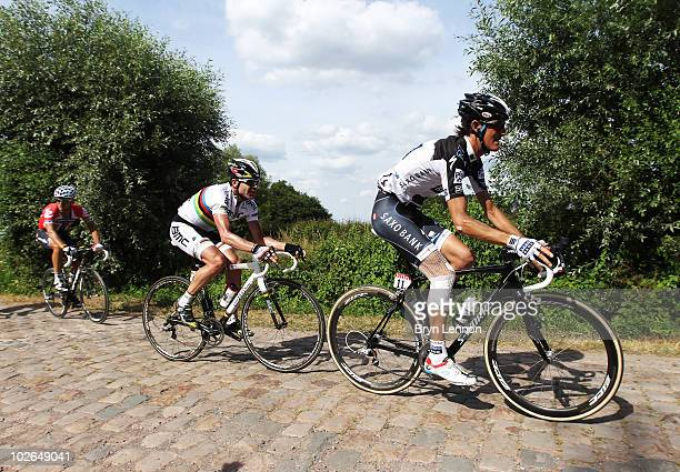 Andy Schleck of Luxembourg and Team Saxobank leads Cadel Evans of Australia and BMC Racing over the cobble stones during stage three of the 2010 Tour...