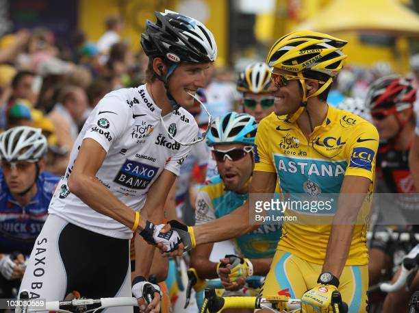 Andy Schleck of team Saxo Bank congratulates Alberto Contador of team Astana at the start of the twentieth and final stage of Le Tour de France 2010,...